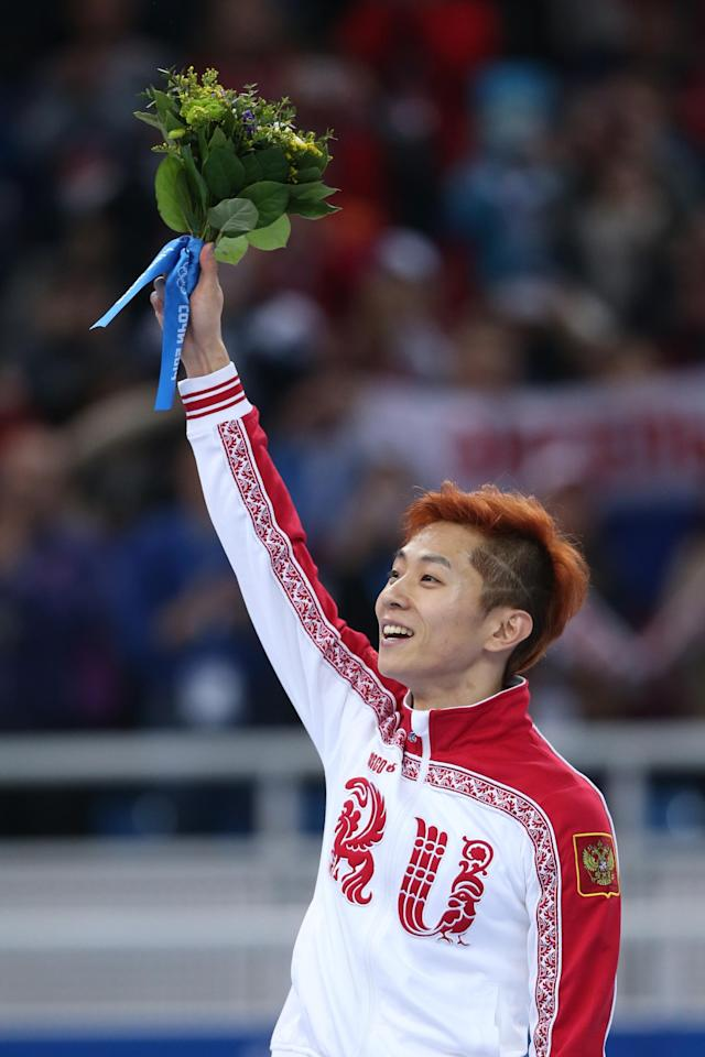 SOCHI, RUSSIA - FEBRUARY 21: Gold medalist Victor An of Russia celebrates during the flower ceremony for the Short Track Men's 500m on day fourteen of the 2014 Sochi Winter Olympics at Iceberg Skating Palace on February 21, 2014 in Sochi, Russia. (Photo by Matthew Stockman/Getty Images)