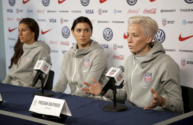 Carli Lloyd, Alex Morgan and Megan Rapinoe would have made nearly four times as much if playing under the men's CBA, per a new court filing. (AP Photo/Seth Wenig)