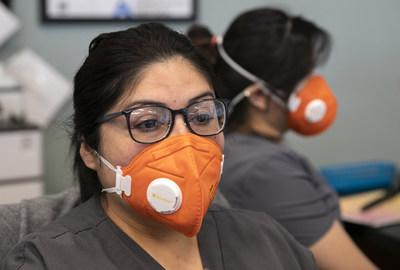 Heathcare workers in San Jose, California, wear N95 masks provided by Direct Relief, which has worked to equip frontline health workers with protective gear during the Covid-19 outbreak. (Photo by LiPo Ching/San Francisco Chronicle/Polaris)