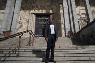 Pap Ndiaye, a Black French scholar and expert on the U.S. civil rights movement poses for a photo outside France's National Museum of the History of Immigration, in Paris, Thursday, March 11, 2021. Ndiaye, who is taking over France's state-run immigration museum, advocates for a better understanding of France's long history of slavery and colonialism and the role of immigration in the construction of the country as key in the fight against racial injustice and discrimination. (AP Photo/Francois Mori)