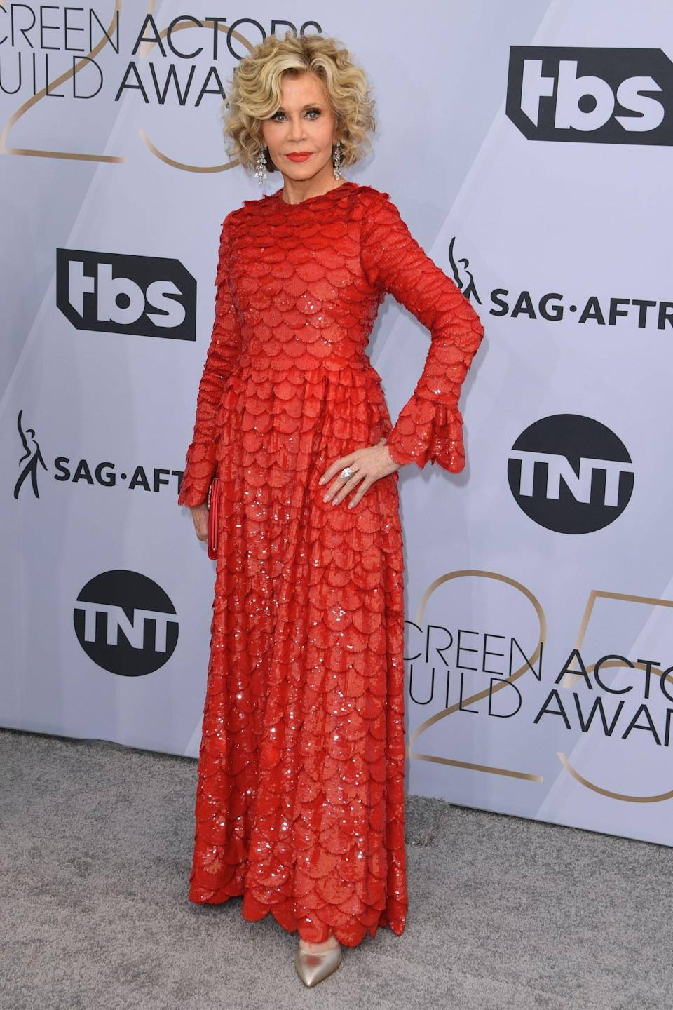 <p>Wearing a red Valentino gown with Gismondi 1754 jewels, Sarah Flint shoes, and a Roger Vivier clutch.</p>