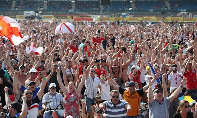 Fans watch England v Sweden on a big screen at Silverstone after the British Grand Prix.