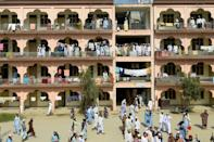 Students gather in the premises of the hostel at the Darul Uloom Haqqania seminary