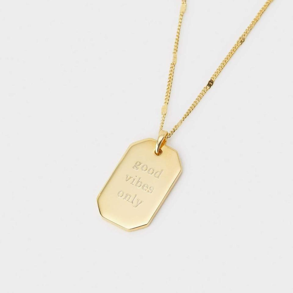 """<h3><a href=""""https://gorjana.com/collections/engravable/products/bespoke-dog-tag-pendant-necklace"""" rel=""""nofollow noopener"""" target=""""_blank"""" data-ylk=""""slk:Gorjana Bespoke Dog Tag Necklace"""" class=""""link rapid-noclick-resp"""">Gorjana Bespoke Dog Tag Necklace</a></h3><br>Customize this shiny dog tag pendant by engraving a date, her initials, or even a special phrase. <br><br><strong>Gorjana</strong> Bespoke Dog Tag Pendant Necklace, $, available at <a href=""""https://go.skimresources.com/?id=30283X879131&url=https%3A%2F%2Fgorjana.com%2Fcollections%2Fengravable%2Fproducts%2Fbespoke-dog-tag-pendant-necklace"""" rel=""""nofollow noopener"""" target=""""_blank"""" data-ylk=""""slk:Gorjana"""" class=""""link rapid-noclick-resp"""">Gorjana</a>"""
