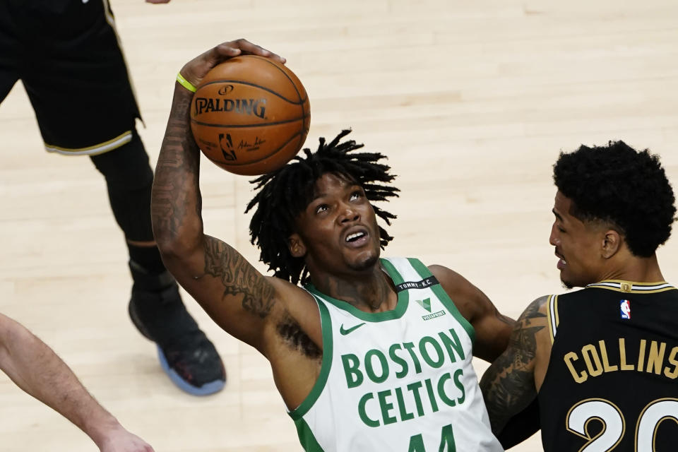 Boston Celtics center Robert Williams III (44) works against Atlanta Hawks forward John Collins (20) In the second half of an NBA basketball game Wednesday, Feb. 24, 2021, in Atlanta. (AP Photo/John Bazemore)