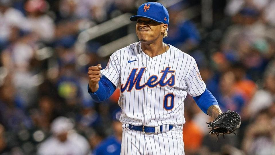 Jun 17, 2021; New York City, New York, USA; New York Mets starting pitcher Marcus Stroman (0) punches his chest during the seventh inning against the Chicago Cubs at Citi Field.