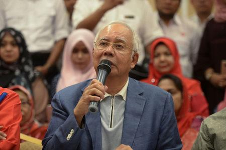 Ousted Malaysian Prime Minister Najib Razak speaks during a news conference in Kuala Lumpur