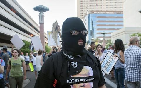 Demonstrators gather outside the Phoenix, Arizona, Convention Center - Credit: AFP