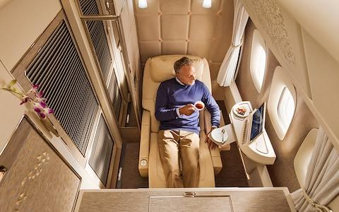 "Emirates' new fully enclosed first class cabins on board its Boeing 777 aircraft will feature full-flat beds that offer a ""zero gravity"" position - Credit: Emirates"