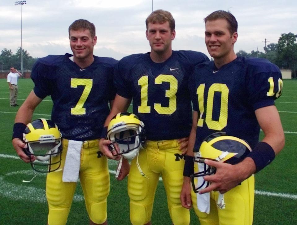 FILE--Michigan quarterbacks from left, Drew Henson, (7), Jason Kapsner, (13) and Tom Brady (10) pose during media day in Ann Arbor, Aug. 13, 1999. Michigan coach Lloyd Carr has refused to name his starting quarteback for Saturday's game, Sept. 4, against Notre Dame, although it's likely to be Tom Brady. (AP Photo/Carlos Osorio, File)