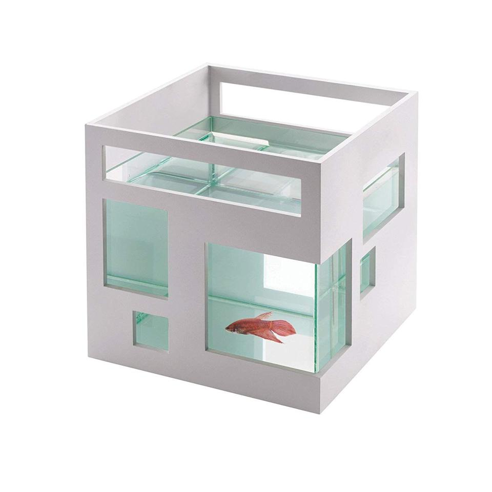 """<h3><strong>Mini Fish Hotel</strong></h3><p>Upgrade your fish into sweeter digs with this sleek and modern, hotel-style aquarium.</p><br><br><strong>Umbra</strong> FishHotel Mini Aquarium, $30, available at <a href=""""https://www.amazon.com/Umbra-FishHotel-Aquarium-Goldfish-Bettas/dp/B0033FGDRS"""" rel=""""nofollow noopener"""" target=""""_blank"""" data-ylk=""""slk:Amazon"""" class=""""link rapid-noclick-resp"""">Amazon</a>"""