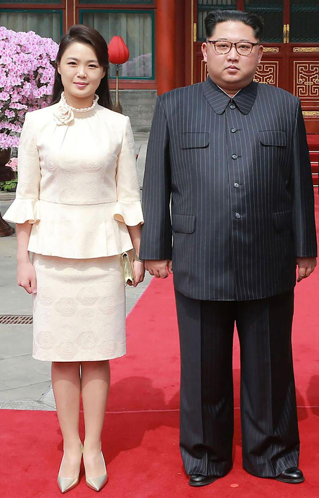 <p>This picture from North Korea's official Korean Central News Agency (KCNA) taken on March 27, 2018 and released on March 28, 2018 shows North Korean leader Kim Jong Un and his wife Ri Sol Ju posing for a picture in Beijing. (Photo: KCNA VIA KNS AFP/Getty Images) </p>