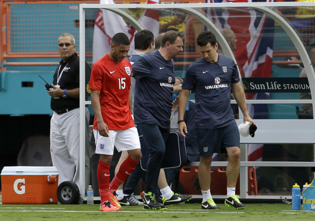 England's Alex Oxlade-Chamberlain (15) walks off the field after he was expelled in the second half of a friendly soccer match against Ecuador in Miami Gardens, Fla., Wednesday, June 4, 2014. The game ended in a 2-2 tie. (AP Photo/Alan Diaz)