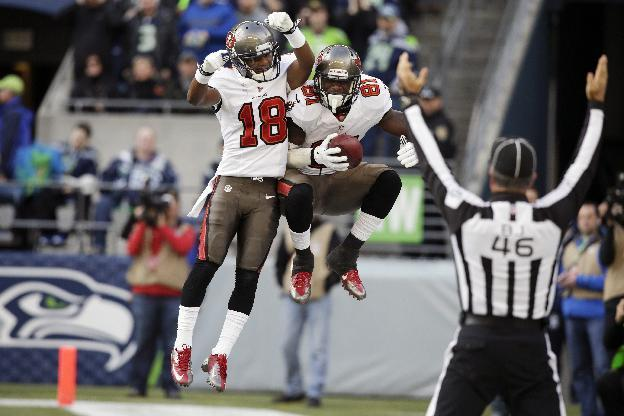 Tampa Bay Buccaneers' tight end Timothy Wright, right, celebrates with wide receiver Skye Dawson (18) after Wright caught a pass for a touchdown against the Seattle Seahawks in the first half of an NFL football game Sunday, Nov. 3, 2013, in Seattle. (AP Photo/Stephen Brashear)
