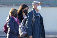 The family of slain Italian doctoral student Giulio Regeni, from left, mother Paola Deffendi, Giulio's sister Irene, and father Claudio Regeni arrive at the Rebibbia prison in Rome, Thursday, Oct. 14, 2021, to attend the first hearing of the trial for the death of Italian doctoral student Giulio Regeni, who disappeared for several days in January 2016 before his body was found on a desert highway north of the Egyptian capital. Italian prosecutors have formally put four high-ranking members of Egypt's security forces under investigation for their alleged roles in the slaying. (AP Photo/Andrew Medichini)