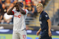 Toronto FC forward Jozy Altidore, left, reacts as Philadelphia Union defender Jakob Glesnes, right, looks on during the first half of an MLS soccer match, Wednesday, Aug. 4, 2021, in Chester, Pa. (AP Photo/Christopher Szagola)