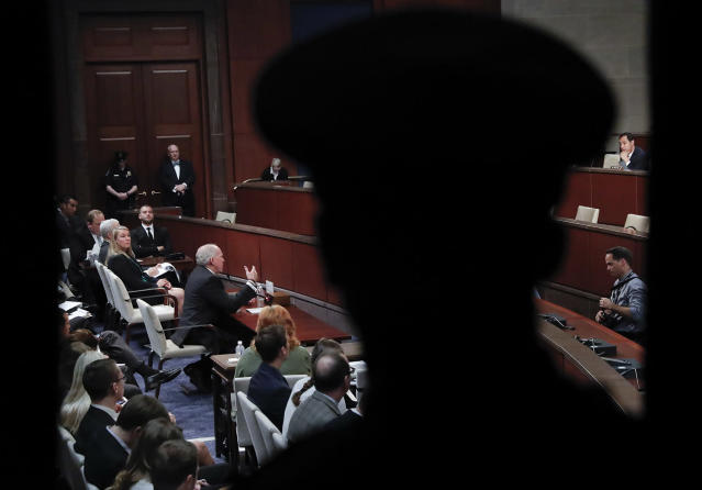 <p>A U.S. Capitol Police officer watches as former CIA Director John Brennan, center, testifies on Capitol Hill in Washington, May 23, 2017, before the House Intelligence Committee Russia Investigation Task Force. (Photo: Pablo Martinez Monsivais/AP) </p>