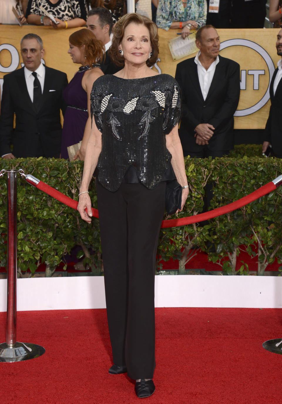 "FILE - Jessica Walter arrives at the 20th annual Screen Actors Guild Awards on Jan. 18, 2014, in Los Angeles. Walter, who played a scheming matriarch in TV's ""Arrested Development,"" has died. She was 80. Walter's death was confirmed Thursday, March 25, 2021, by her daughter, Brooke Bowman. The actor's best-known film roles included playing the stalker in Clint Eastwood's 1971 thriller, ""Play Misty for Me."" (Photo by Jordan Strauss/Invision/AP, File)"