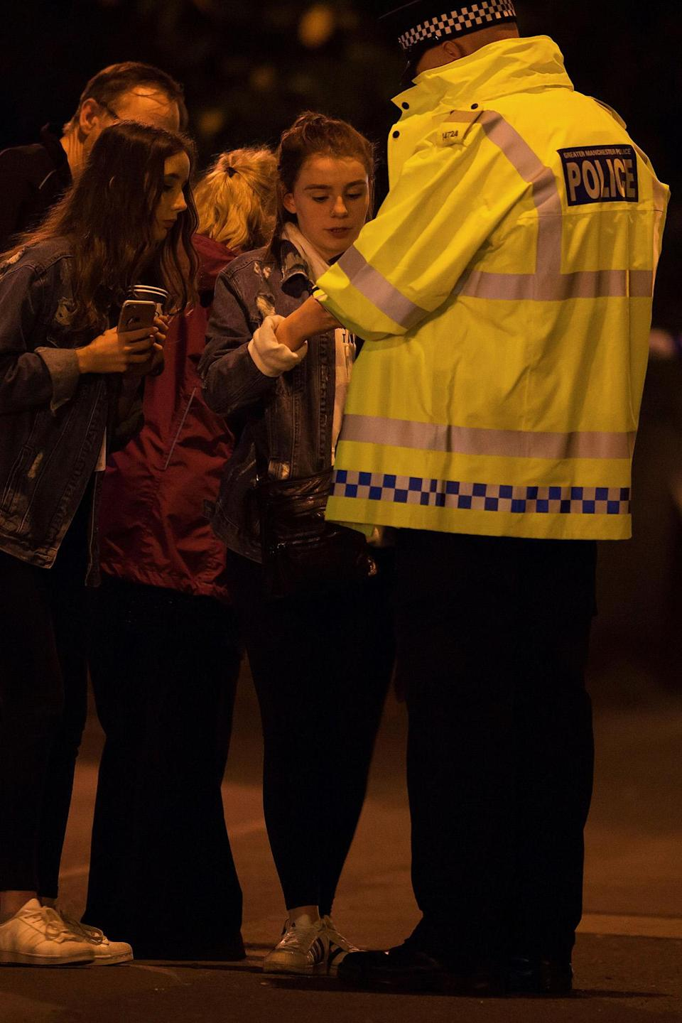 <p>A police officer talks to locals outside the Manchester Arena, where U.S. singer Ariana Grande had been performing, in Manchester, northern England, Britain May 22, 2017. (Jon Super/Reuters) </p>