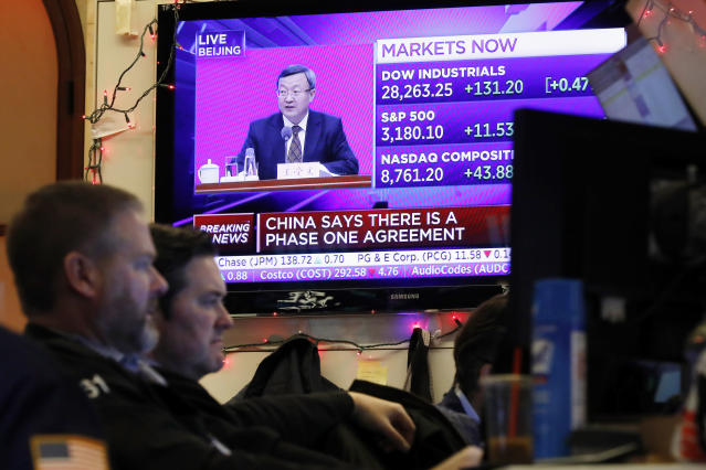 A TV screen on 13 December as the US and China said they had reached an initial deal on trade. Photo: AP Photo/Richard Drew