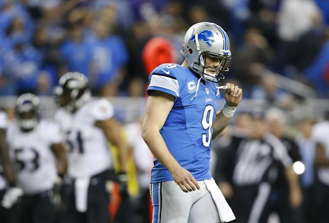 Detroit Lions quarterback Matthew Stafford (9) walks off the field after Baltimore Ravens free safety Matt Elam (26) intercepted his pass during the fourth quarter of an NFL football game in Detroit, Monday, Dec. 16, 2013. (AP Photo/Rick Osentoski)
