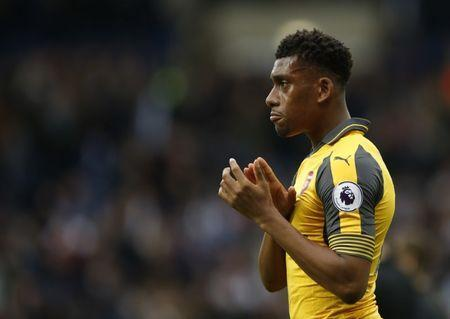 Britain Football Soccer - West Bromwich Albion v Arsenal - Premier League - The Hawthorns - 18/3/17 Arsenal's Alex Iwobi applauds fans after the match Action Images via Reuters / Andrew Boyers Livepic