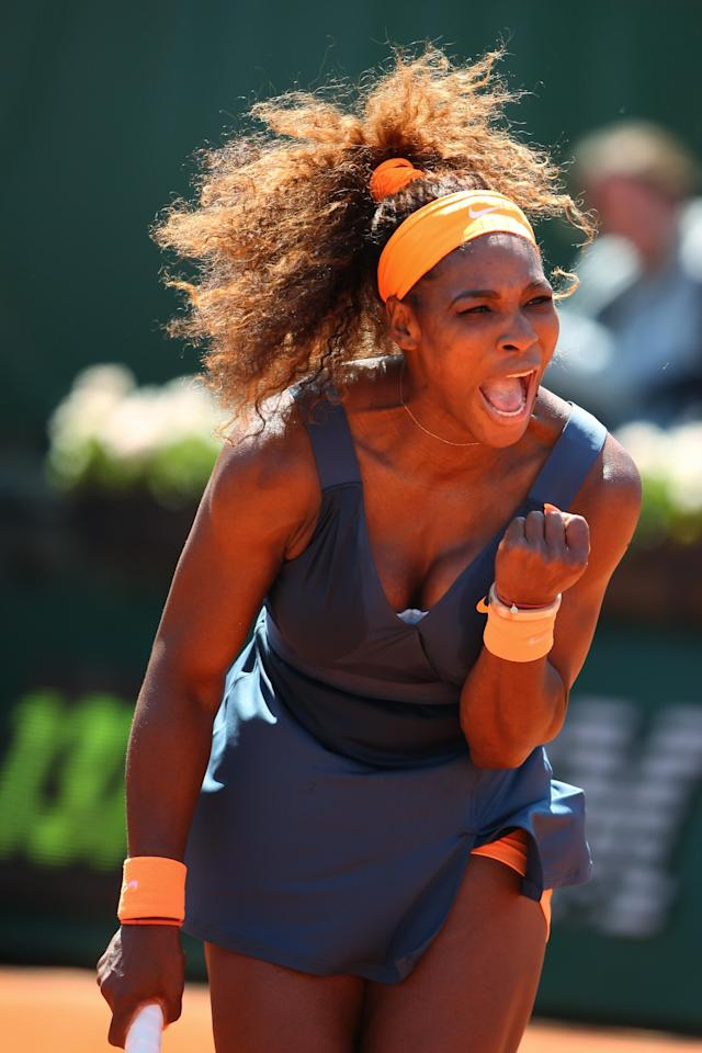 PARIS, FRANCE - JUNE 04: Serena Williams of United States of America celebrates a point during her Women's Singles Quarter-Final match against Svetlana Kuznetsova of Russia on day ten of the French Open at Roland Garros on June 4, 2013 in Paris, France. (Photo by Julian Finney/Getty Images)