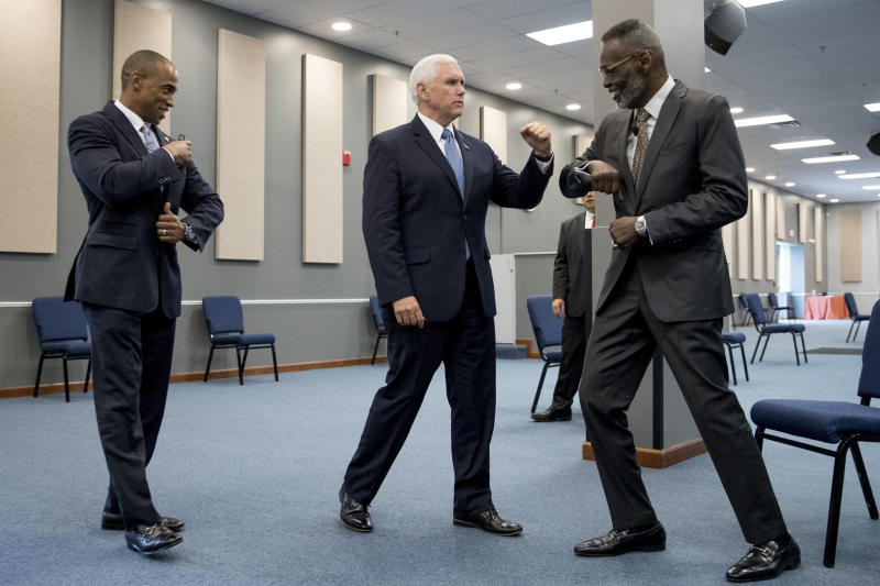 Vice President Mike Pence, center, accompanied by Scott Turner, Executive Director of the White House Opportunity and Revitalization Council, left, greets Bishop Harry Jackson as he meets with community and faith leaders at Hope Christian Church, Friday, June 5, 2020, in Beltsville, Md. (AP Photo/Andrew Harnik)