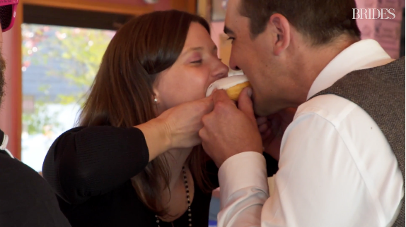 Your first kiss as a married couple can and should include a doughnut.  (Brides.com)