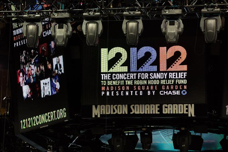 """Signage for the """"12-12-12"""" concert is displayed on the Madison Square Garden jumbotron, Tuesday, Dec. 11, 2012, in New York. The Dec. 12 concert, whose proceeds will aid victims of Superstorm Sandy, will feature artists Bon Jovi, Eric Clapton, Dave Grohl, Billy Joel, Alicia Keys, Chris Martin, The Rolling Stones, Bruce Springsteen & the E Street Band, Eddie Vedder, Roger Waters, Kanye West, The Who and Paul McCartney. (AP Photo/John Minchillo)"""