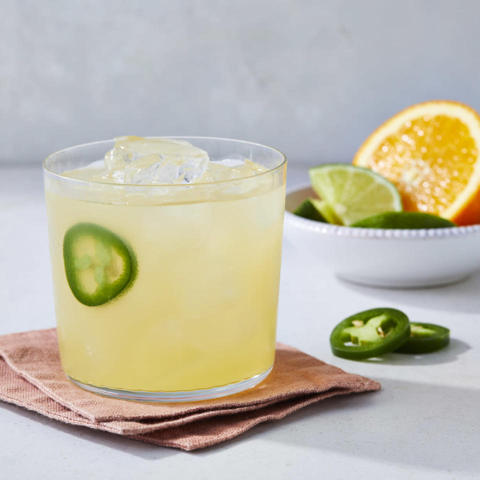 <p>This reduced-sugar jalapeño margarita is a drink with a kick! We sweeten this zippy cocktail with fresh orange juice and just a touch of simple syrup steeped with slices of jalapeño. If you like the heat, add more chile slices to the sugar mixture.</p>