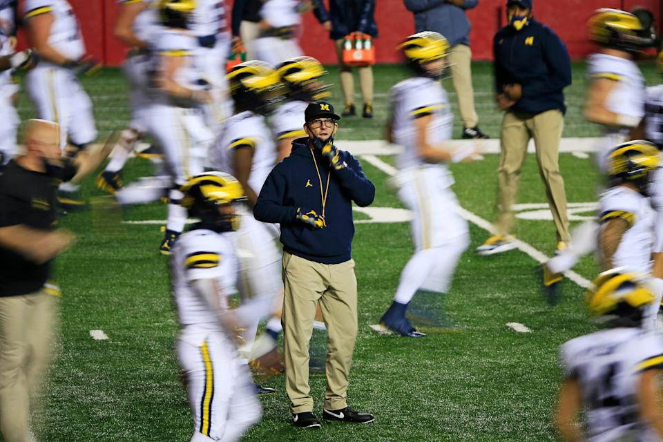 Head coach Jim Harbaugh of the Michigan Wolverines warms up his team before the game against the Rutgers Scarlet Knights at SHI Stadium on Nov. 21, 2020 in Piscataway, New Jersey.