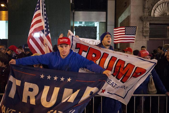 <p>U.S. Republican presidential nominee Donald Trump supporters rally near the intersection of West 54th Street and Fifth Avenue in New York, Nov. 8, 2016. (Photo: Alex Wroblewski/Reuters) </p>