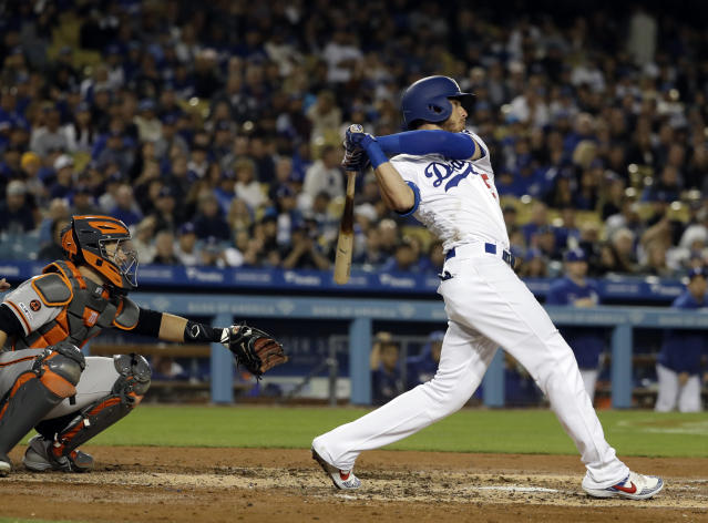 Los Angeles Dodgers' Cody Bellinger follows through on his grand slam off San Francisco Giants' Madison Bumgarner during the third inning of a baseball game Tuesday, April 2, 2019, in Los Angeles. (AP Photo/Marcio Jose Sanchez)