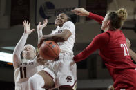 Boston College forward Taylor Soule (13) tries to control a rebound against Louisville forward Kylee Shook (21) as Boston College forward Emma Guy (11) is at left during the second half of an NCAA college basketball game Thursday, Jan. 16, 2020, in Boston. (AP Photo/Elise Amendola)