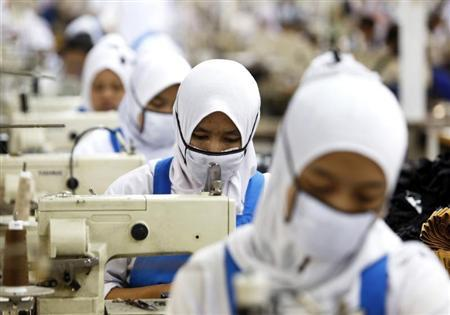 Worker performs stitch-processing at PT Trisula Garmindo Manufacturing in Bandung