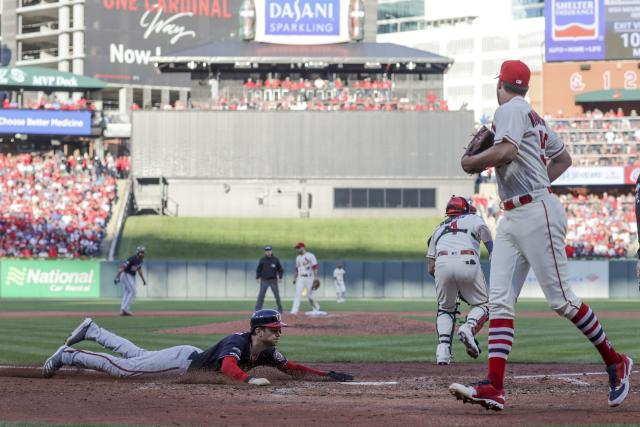 Washington Nationals' Trea Turner scores safely on a two-run scoring double by Adam Eaton during the eighth inning of Game 2 of the baseball National League Championship Series against the St. Louis Cardinals Saturday, Oct. 12, 2019, in St. Louis. (AP Photo/Jeff Roberson)