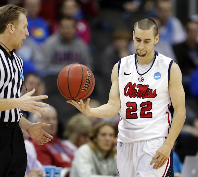 Mississippi guard Marshall Henderson (22) hands the ball to a referee during the first half of a third-round game against La Salle in the NCAA college basketball tournament at the Sprint Center in Kansas City, Mo., Sunday, March 24, 2013. (AP Photo/Orlin Wagner)