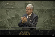 In this UNTV image, Volkan Bozkir, President of the 75th session of the United Nations General Assembly, applauds as he delivers closing remarks, Tuesday, Sept. 29, 2020, at U.N. headquarters. (UNTV via AP)