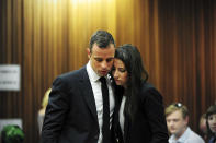 Olympic and Paralympic track star Oscar Pistorius stands beside his sister Aimee during court proceedings at the North Gauteng High Court in Pretoria March 19, 2014. Pistorius is on trial for murdering his girlfriend Reeva Steenkamp at his suburban Pretoria home on Valentine's Day last year. REUTERS/Leon Sadiki/Pool (SOUTH AFRICA - Tags: SPORT CRIME LAW ATHLETICS)