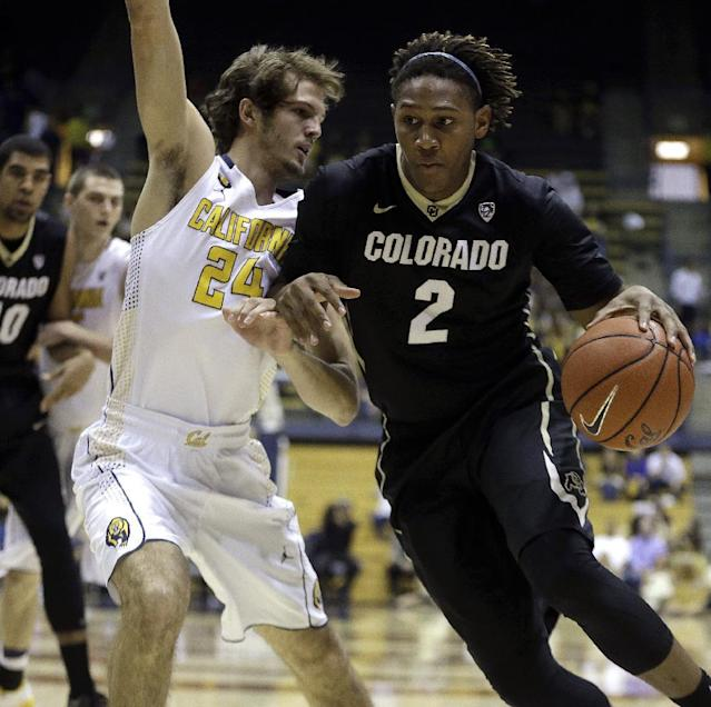 Colorado's Xavier Johnson (2) drives the ball against California's Ricky Kreklow, left, in the first half of an NCAA college basketball game on Saturday, March 8, 2014, in Berkeley, Calif. (AP Photo/Ben Margot)