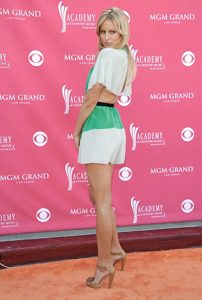 """We know that Karolina Kurkova is a Victoria's Secret Angel and that she's got legs that go on for miles, but her green and white ensemble was a tad short for the occasion. Charley Gallay/<a href=""""http://www.gettyimages.com/"""" target=""""new"""">GettyImages.com</a> - May 18, 2008"""