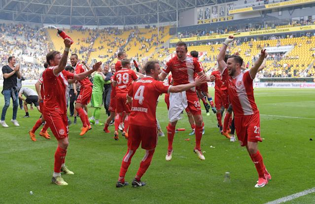Soccer Football - 2. Bundesliga - Dynamo Dresden v Fortuna Dusseldorf - DDV-Stadion, Dresden, Germany - April 28, 2018 Fortuna Dusseldorf celebrate after gaining promotion REUTERS/Matthias Rietschel DFL RULES TO LIMIT THE ONLINE USAGE DURING MATCH TIME TO 15 PICTURES PER GAME. IMAGE SEQUENCES TO SIMULATE VIDEO IS NOT ALLOWED AT ANY TIME. FOR FURTHER QUERIES PLEASE CONTACT DFL DIRECTLY AT + 49 69 650050