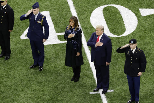 President Donald Trump, second from right, and first lady Melania Trump attend the NCAA College Football Playoff national championship game Monday, Jan. 13, 2020, in New Orleans. (AP Photo/Eric Gay)