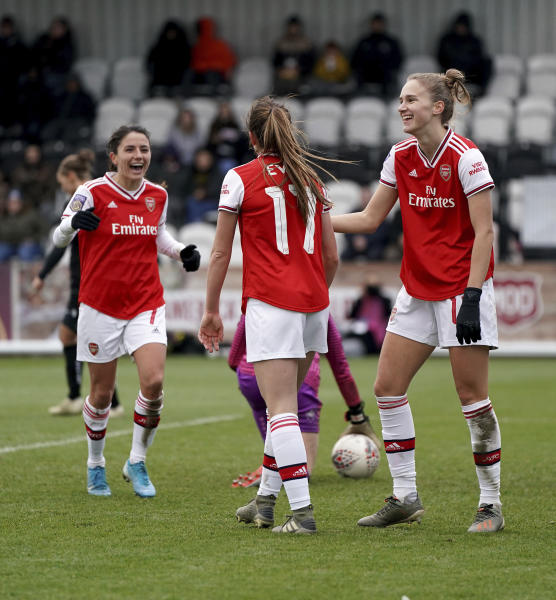 Arsenal's Vivianne Miedema, right, celebrates scoring during the FA Women's Super League match against Bristol City at Meadow Park, Borehamwood, England, Sunday Dec. 1, 2019. (Tess Derry/PA via AP)