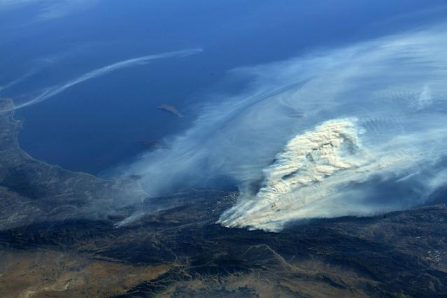 <p>A photo taken from the International Space Station and moved on social media by astronaut Randy Bresnik shows smoke rising from wildfire burning in Southern California, Dec. 5, 2017. (Photo: @AstroKomrade/NASA/Handout via Reuters) </p>