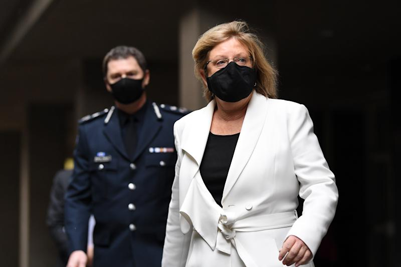 Victoria Police Minister Lisa Neville (right) arrives to the press conference Tuesday. Source: AAP