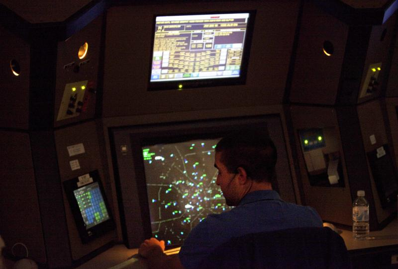 FILE - An air traffic controller works in a terminal radar approach control room in this April 18, 2011 file photo taken at the Atlanta TRACON in Peachtree City, Ga. Errors by air traffic controllers in the vicinity of airports as well as incidents in which there was an unauthorized plane, vehicle, or person on a runway have increased sharply, a government watchdog said in a report released Thursday Oct. 13, 2011. The Federal Aviation Administration attributed the increases in controller errors to better error reporting.  (AP Photo/David Goldman, Pool - File)