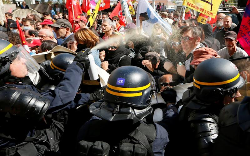 Demonstrators face off with French CRS riot police as they attend a national strike and protest against the government's labour reforms in Lyon, France, September 12 - REUTERS