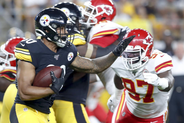 Pittsburgh Steelers running back James Conner (30) runs away from Kansas City Chiefs defensive end Alex Okafor (97) in the first half of a preseason NFL football game, Saturday, Aug. 17, 2019, in Pittsburgh. (AP Photo/Don Wright)
